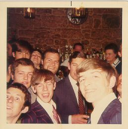Edinburgh run ashore. HRH [the DO] enjoying a drink with members of his division. September 1974.