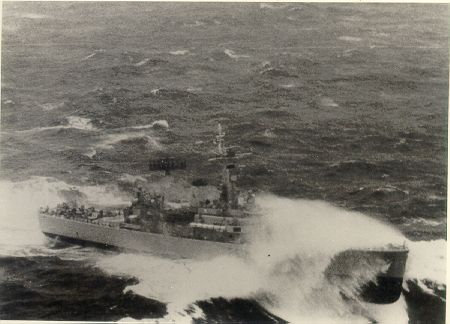 In rough weather with bow high out of the water.  Leander frigates are good sea boats and this is a good action shot of HMS Jupiter going about her business on the high seas.