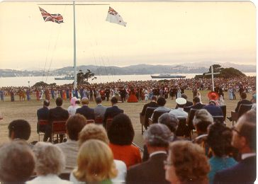 Waitangi Bay early 1974.  The daytime event [see picture to left] of celebrating the 150th anniversary of the signing of the Treaty of Waitangi by HM Queen Victoria.  HM Queen Elizabeth can be seen to the right wearing a red hat.  In the distance, we see the Royal Yacht Britannia and the frigate HMS Jupiter.